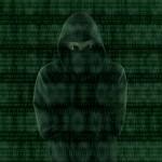 Hacker looking at binary code