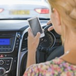 Female Driver Sending Text Message Whilst Driving